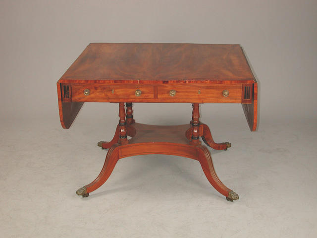 A Regency mahogany sofa table, the top with kingwood cross banding and coromandel stringing, on four tuned surports and reeded out s...