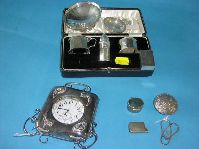 An Edwardian silver cased travel clock