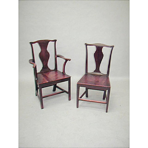 A near set of eight George III and later elm and oak country chairs,
