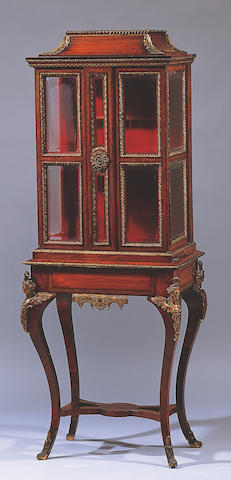 A Victorian inlaid kingwood and gilt metal mounted display cabinet on stand,