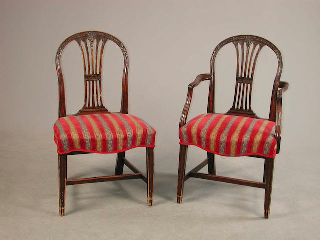 A set of eight mahogany dining chairs,  in the Hepplewhite style,