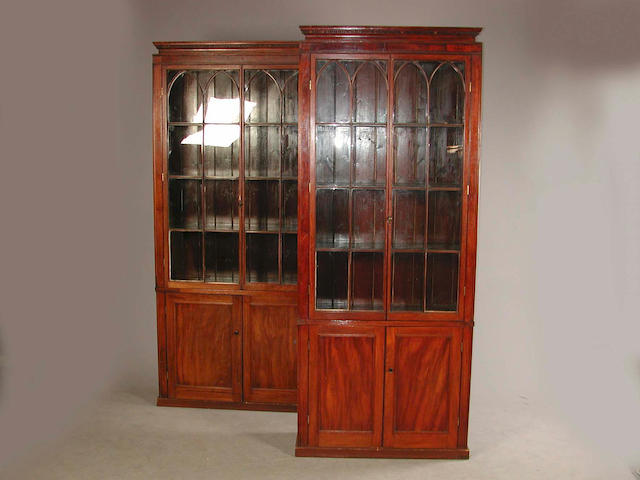 Two matching mahogany bookcases in the Regency style