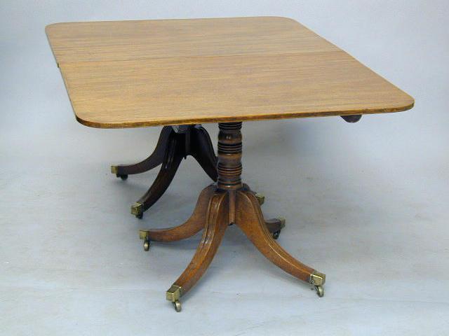 A Regency mahogany twin pedestal dining table,