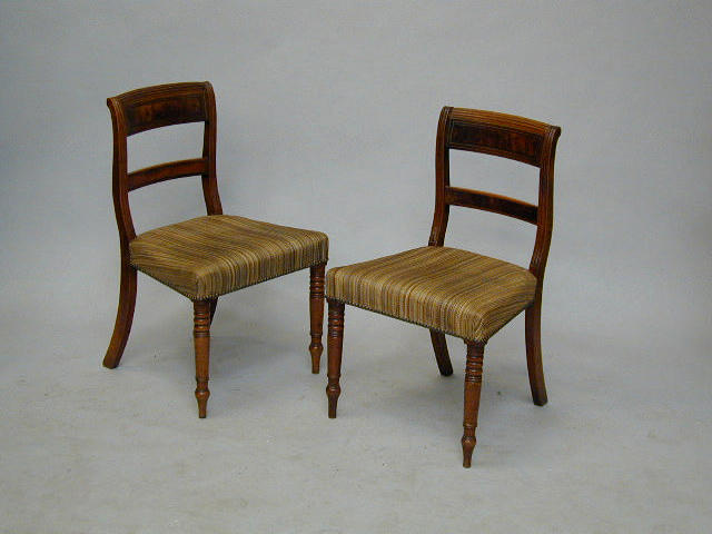 A set of six Regency mahogany and brass inlaid dining chairs,