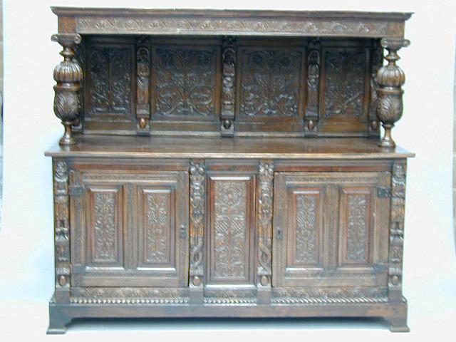 A carved oak court cupboard,