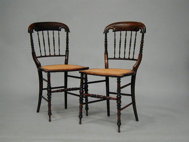 A set of six Victorian spindle back dining chairs,