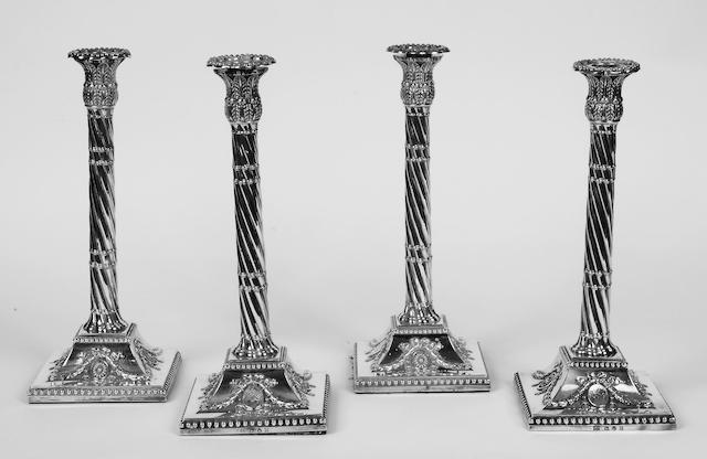 A set of four George III silver candlesticks,