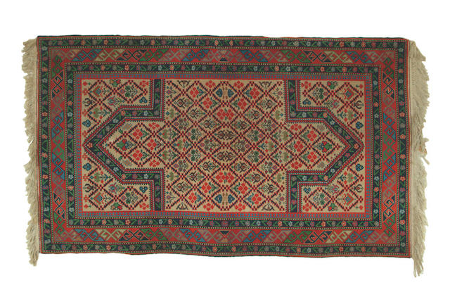 A Dagestan ivory ground rug,