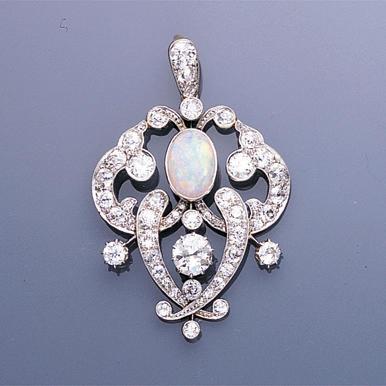 A diamond and opal pendant,