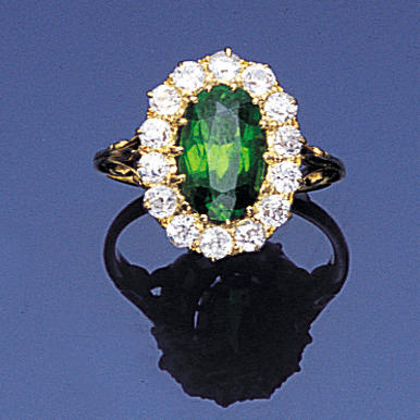 A late Victorian demantoid garnet and diamond cluster ring