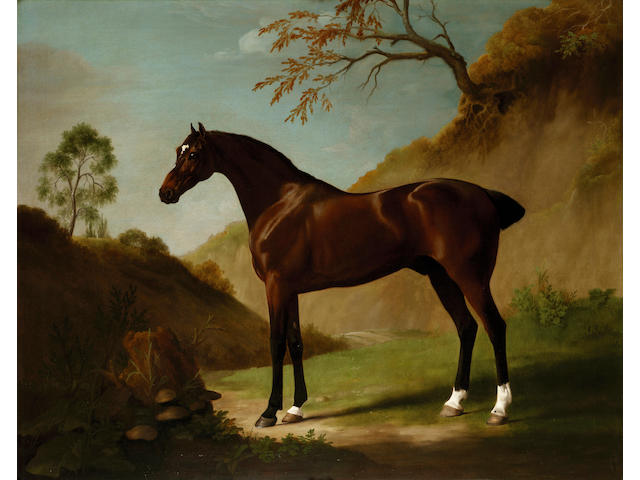 George Stubbs (Liverpool 1724-1806 London) A dark bay thoroughbred in a landscape 101.7 x 127 cm. (40 x 50 in.)