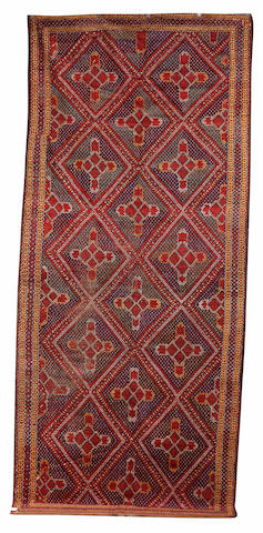 An Ersari Beshir gallery carpet,  Afghanistan,  the madder field of quartered green and blue lozenge medallions framed by a madder diamond chain border, retaining kilim endstripes,