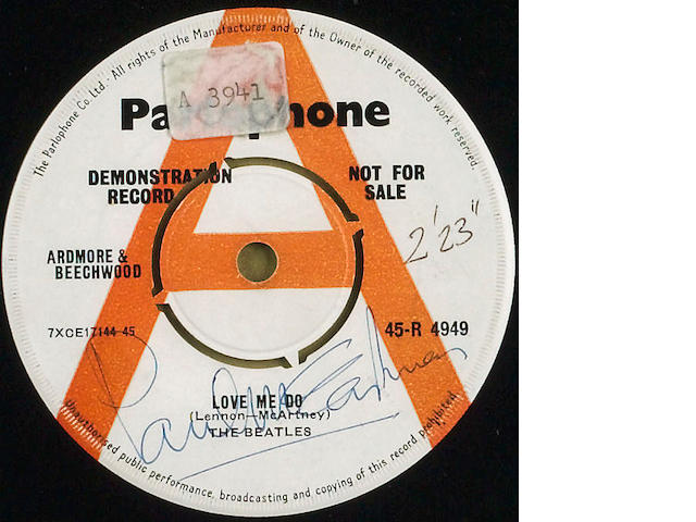 A demonstration single for The Beatles 'Love Me Do/'P.S. I Love You' autographed by Paul McCartney