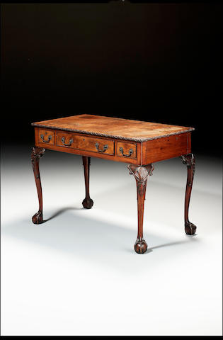 A George III carved mahogany Side Table  in the manner of Thomas Chippendale, 116 cm. wide, 61 cm. deep, 81 cm high.