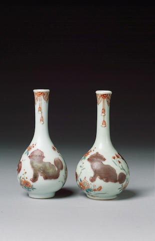 A pair of small bottle vases circa 1700-20