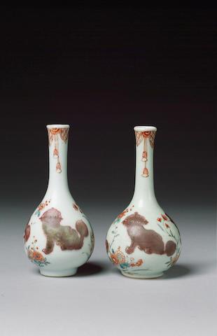 pair of bottle vases, underglaze red kylin