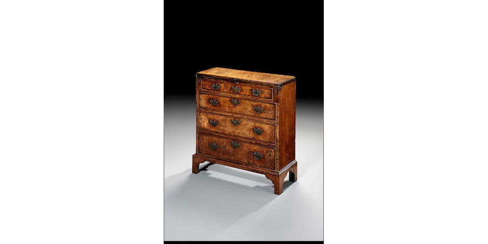 A figured walnut, crossbanded and featherbanded Bachelor's Chest,