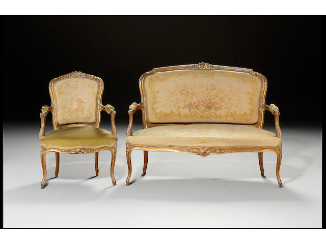 A Louis XV style gilt salon suite comprising of a sofa and six matched fauteuils