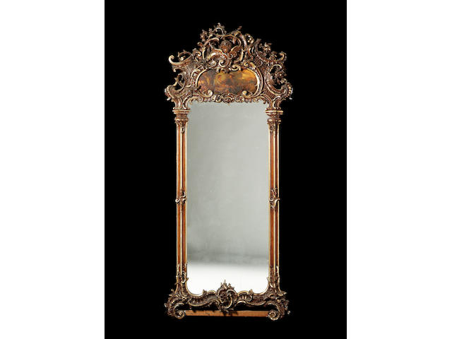 A Louis XV style gilt and wood grained pier mirror, 273cm. high, 116cm. wide