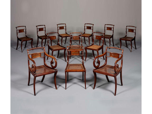 A set of twelve Regency mahogany and brass inlaid Dining Chairs including two Armchairs