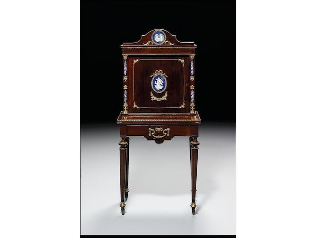 A Louis XVI style walnut and gilt metal mounted bonheur du jour 66cm. wide, 44cm. deep, 50cm. high.