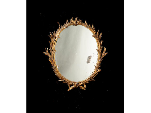 A George III giltwood Mirror, 110cm. high, 100cm. wide