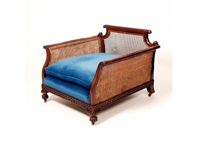 An early 20th Century mahogany two piece bergere suite, settee 198cm wide.