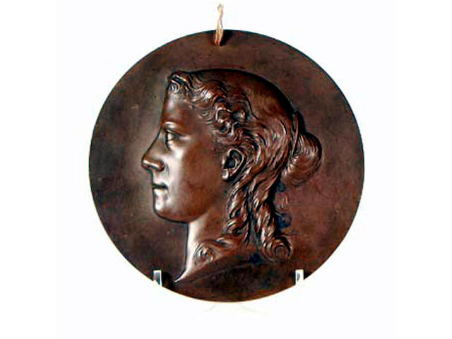 A bronze plaque of a classical woman, L Godon 68, 20cm diameter.