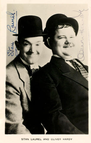 An autographed photograph of Laurel & Hardy 1930's 14 x 9 cm.