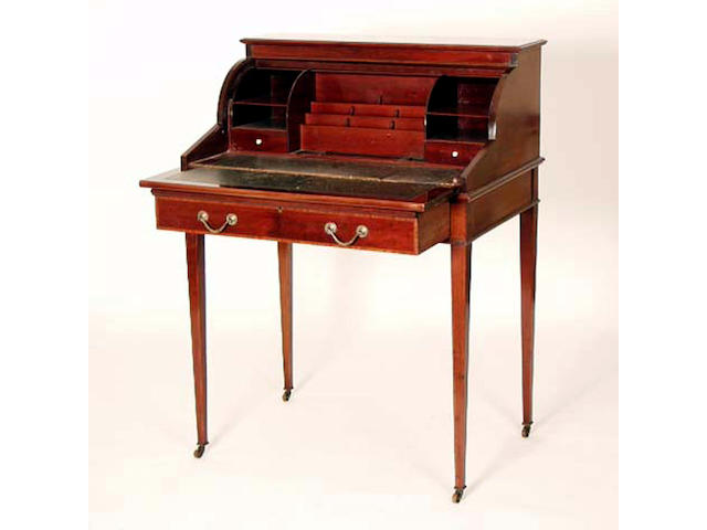 An Edwardian mahogany cylinder desk, Maple & Co, 76cm wide. See Illustration.