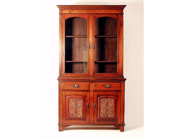 A late Victorian walnut glazed bookcase, 125cm wide.
