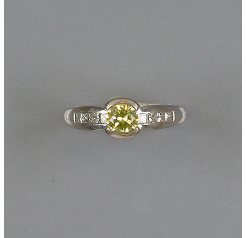 An irradiated diamond single-stone ring