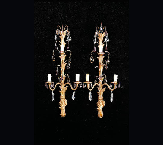 A set of four early 20th century giltwood and cut glass three light Wall Appliques, 90cm. high