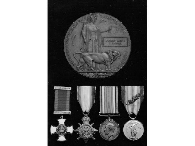 A Great War D.S.O. group of four to Lieutenant Colonel D.R.Turnbull, Gordon Highlanders and Manchester Regiment, Distinguished Service Order, G.V.R. in silver-gilt and enamel; 1914 Star (2.Lieut D.R.Turnbull Gord:Highrs); British War and Victory Medal with MID oakleaf (Lt.Col.D.R.Turnbull.); Memorial Plaque (Dudley Ralph Turnbull). Together with Memorial Scroll and medals slips, newspaper cuttings, letter etc.