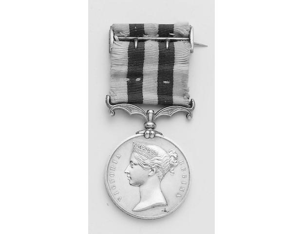 Single Campaign Medals pre 1900, Indian Mutiny 1857-1858, no bar (Bt Major G.M.Hill, 17th B.N.I.). With original ribbon and silver buckle.