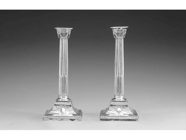 A pair of Victorian silver Ionic column candlesticks, by Rupert Favell & Henry Elliot, London 1888,