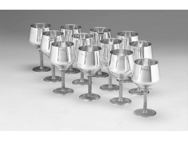 A set of twelve silver goblets, London 1972, and a cased set of six silver goblets, Birmingham 1969,