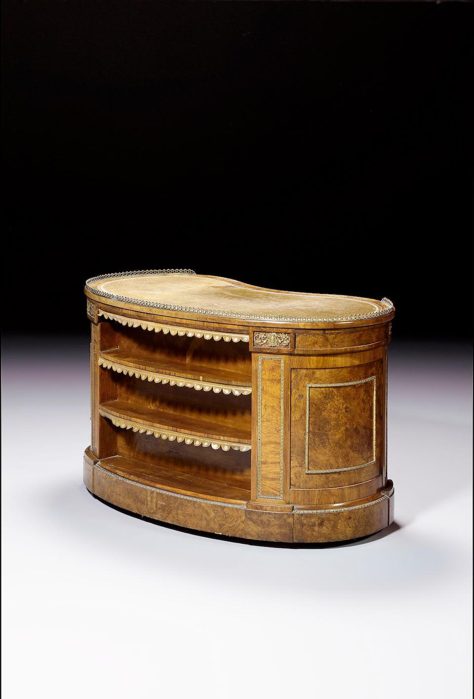 A fine Victorian burr walnut kidney shaped pedestal Desk, applied with gilt metal mounts,