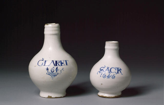 WHITE TIN-OXIDE GLAZED EARTHENWARE CLARET JUG 1645, THE GLOBULAR BODY INSCRIBED WITH CLARET 1645 ABO