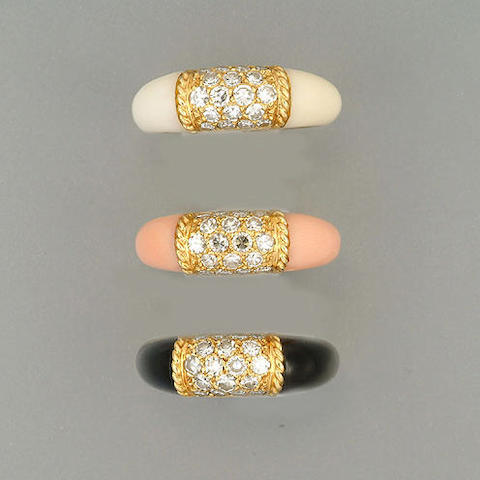 Three diamond set dress rings,