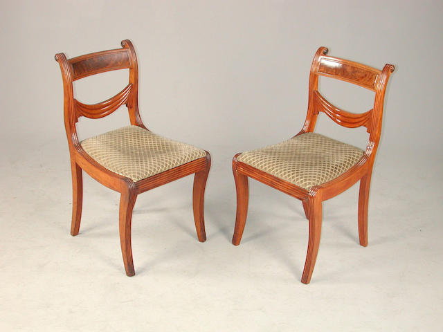 A set of eight Regency dining chairs