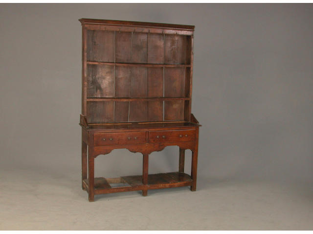An early 18th century oak dresser 128 cms wide x 38 cms deep x 143 high