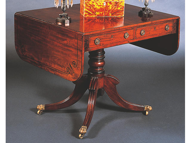 A George IV mahogany and ebony line inlaid sofa table,