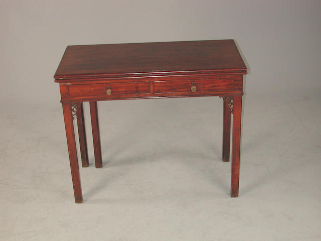 A George III mahogany fold over tea table with two frieze drawers and open fret carving, 92cms wide