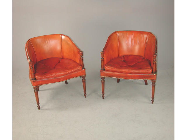 A set of six mahogany framed tub shaped chairs upholstered in orange close buttoned hid