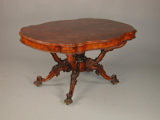 A mid Victorian carved walnut breakfast table 152 cm x 108 cm x 78 cm high