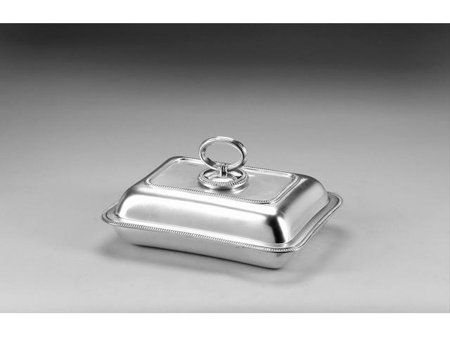 A silver oblong entree dish, cover and detachable divider, by Mappin & Webb, Sheffield 1922, weight 55.5oz.