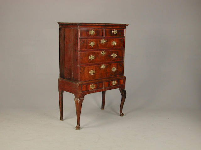 A George I walnut chest on stand 101 cm wide x 54 cm deep x 157 cm high later handles