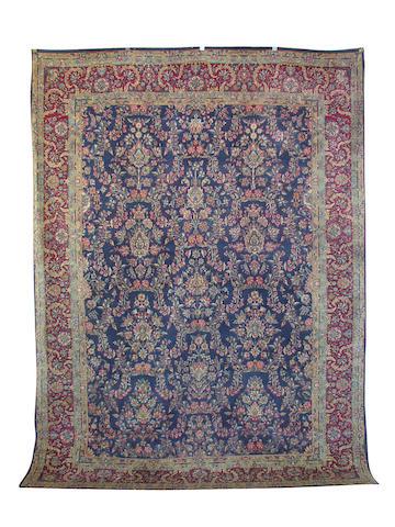 A Kirman carpet, South East Persia, 333 cm. x 241 cm.