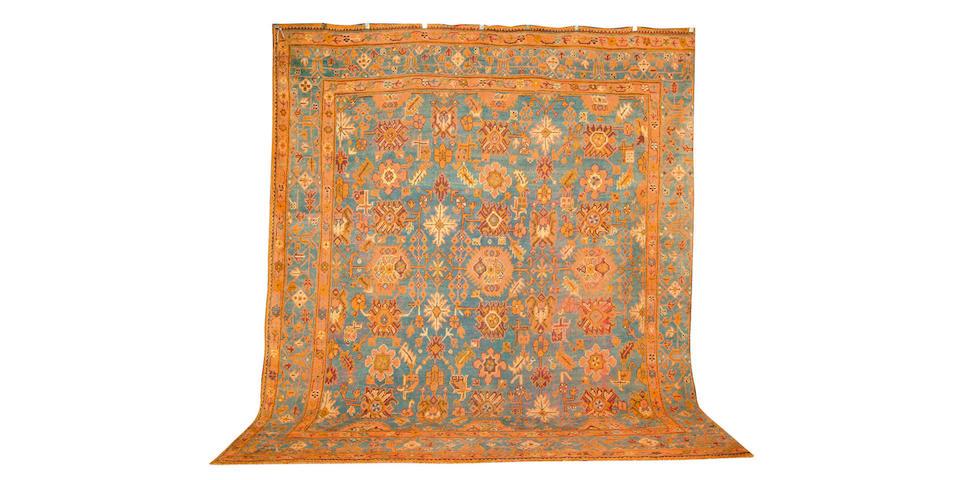 An Ushak Carpet, West Anatolia, 390 cm. x 333 cm.